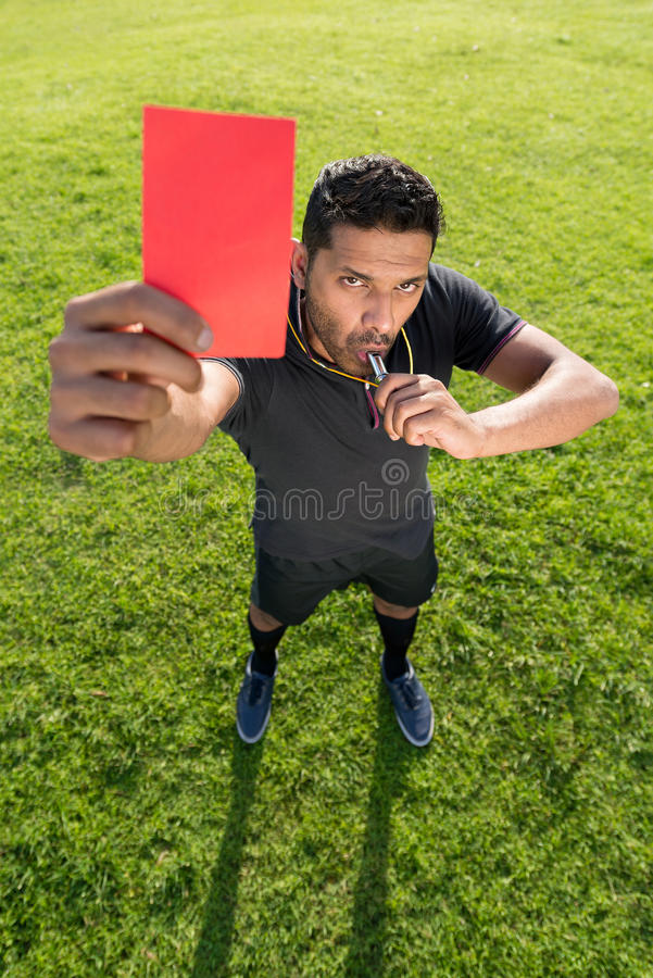 Dismissal. Portrait of referee showing red card as a symbol of dismissal stock photos