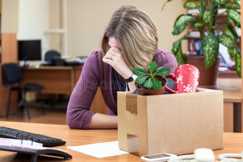 Dismissal at work, weeping employee. With things to take away royalty free stock images
