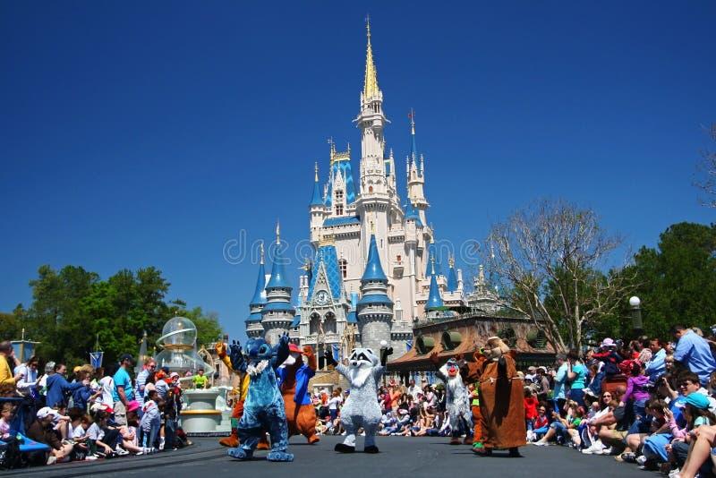 Disney cartoon characters marching parade in Magic Kingdom park. ORLANDO, FL, USA - MARCH 26, 2008: Many Disney cartoon characters marching parade to greeting stock photos