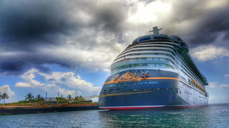 Disney Dream at Castaway Cay. Disney Dream docked at Disney& x27;s private island Castaway Cay located in the Bahamas stock images