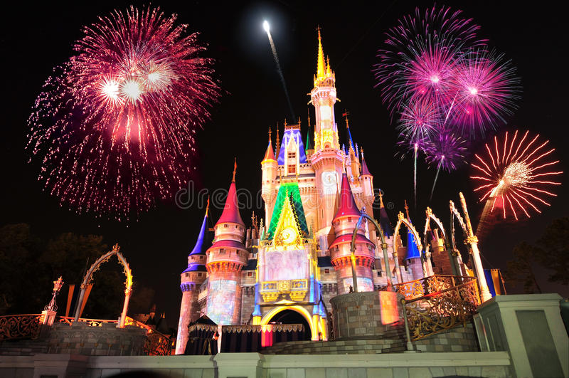 Disney's Cinderella's Castle. Display of fireworks and colorful lights on Cinderella's Castle in Magic Kingdom at DisneyWorld, Orlando, Florida USA