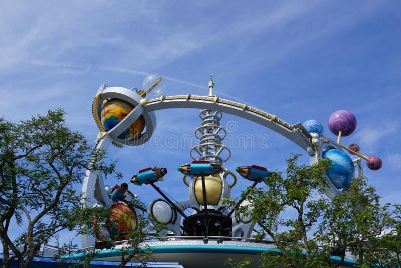Disney World Astro Orbiter Ride at Magic Kingdom. Orlando, FL/USA - 02/07/18: Disney World Astro Orbiter Ride at Magic Kingdom with Rocket circling royalty free stock images