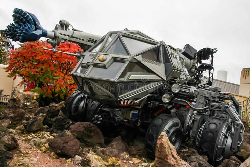 Disneyland Paris - Armageddon. A vehicle simillar to the one in 1998 blockbuster Armageddon featuring Bruce Willis is displayed in fron of one of the rides at stock photo
