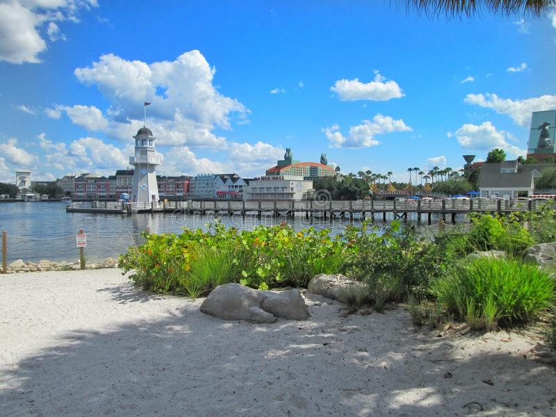 Disneys Yacht Club beach view. A perspective from the beach at Disney Worlds Yacht Club Resort overlooking The pier, The Swan Hotel and the boardwalk stock image