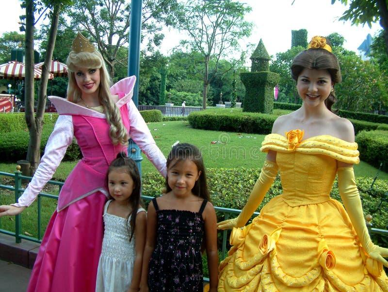 Disneys princesses. Hong Kong, Circa September 2010. Children posing with Disneys Princesses at the Hong Kong Disney resort royalty free stock photography