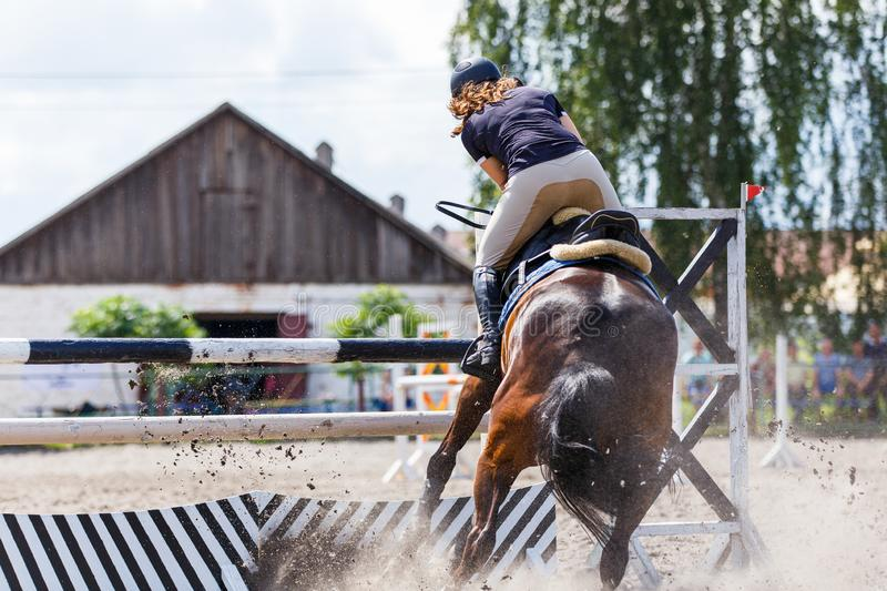 Disobedience of horse on show jumping competition. Disobedience of the horse on show jumping equestrian competition royalty free stock images