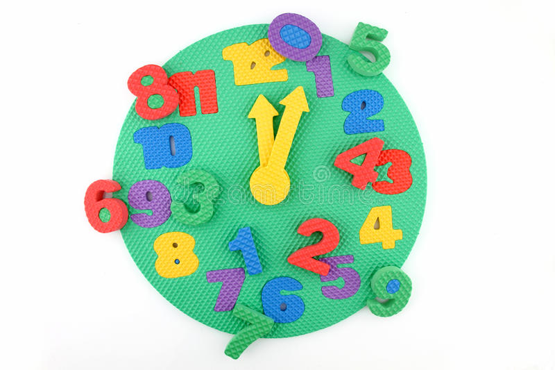 Disorder of time on toy clock. Arranged on white background royalty free stock images