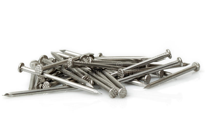 Disordered Pile Of Nails stock image