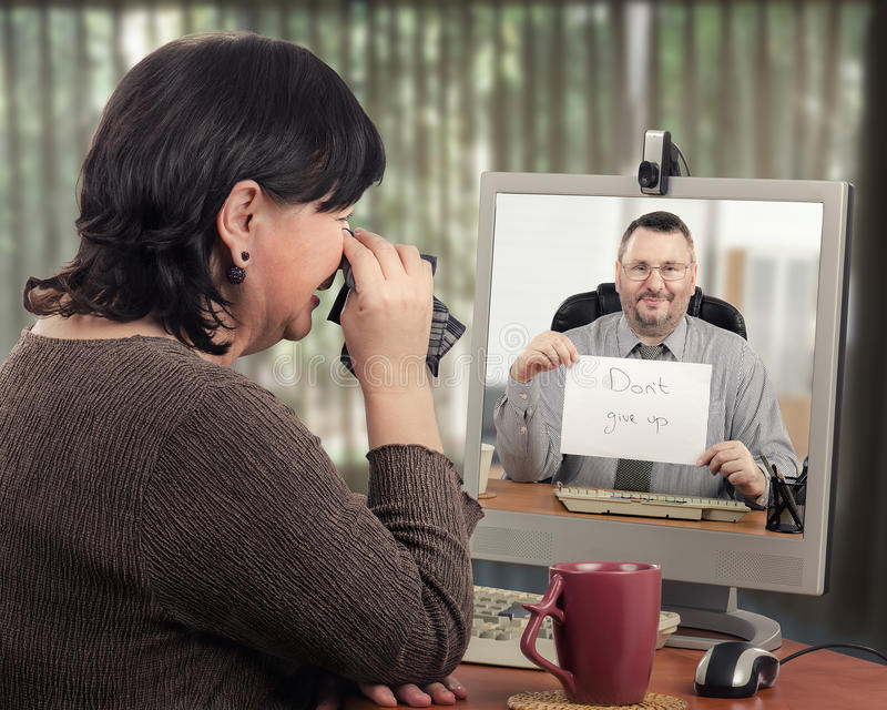 Disordered woman visits telemedicine psychiatrist. Female patient is extremely worried at first meeting with telemedicine psychotherapist. Mature women is crying stock photos
