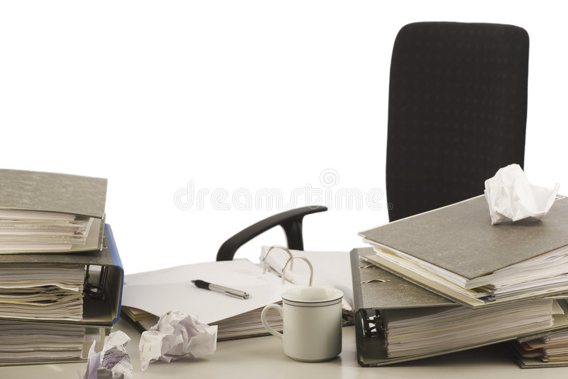 disorganized skrivbord royaltyfria bilder