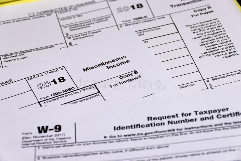 Disparado dos formulários de imposto 1099-M, 1099-K e W-9 do IRS imagens de stock