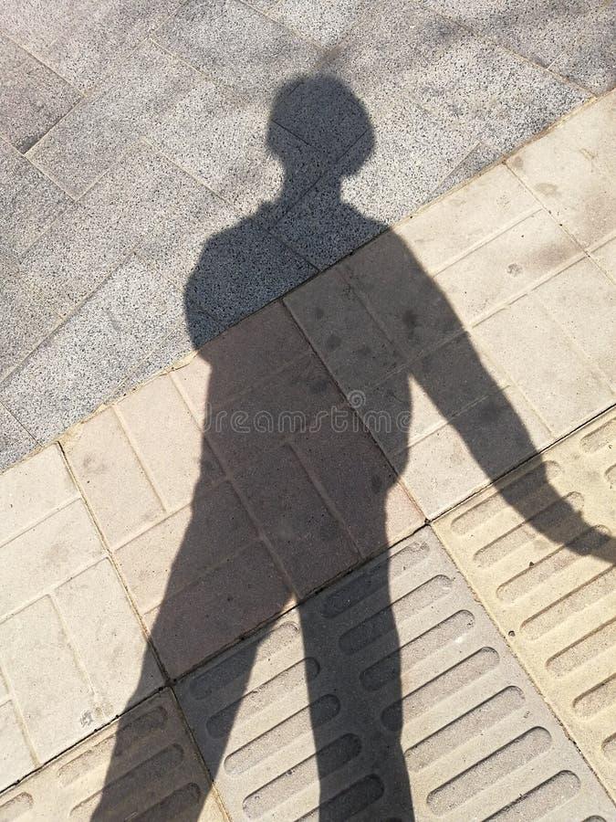 Disparado em minha sombra pacificamente imagem de stock royalty free