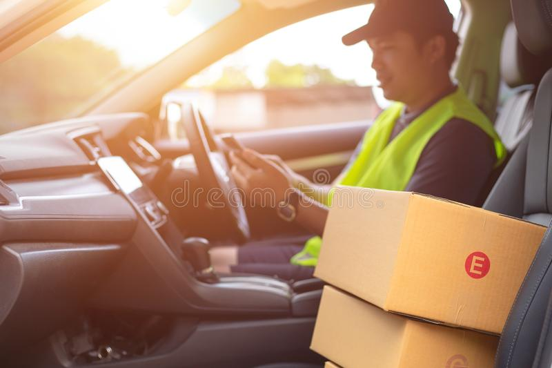 The dispatcher uses the delivery program using a mobile phone. I royalty free stock photography