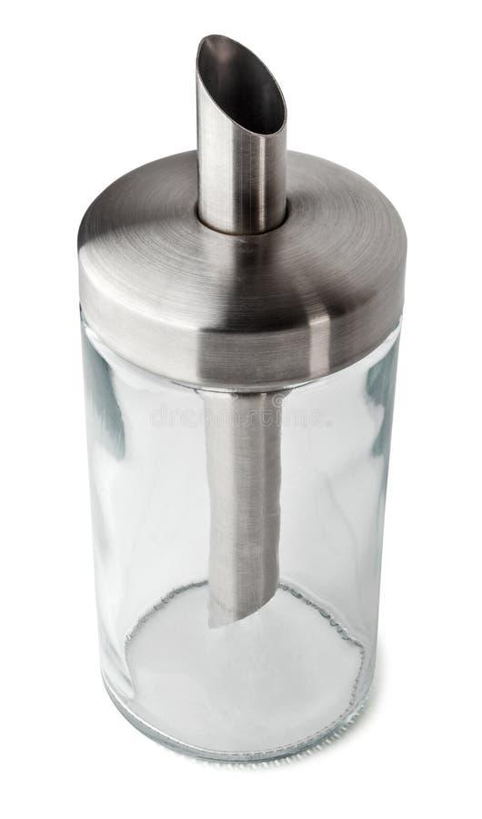 Dispensador de cristal vacío para el azúcar aislado en el fondo blanco con la trayectoria de recortes foto de archivo libre de regalías