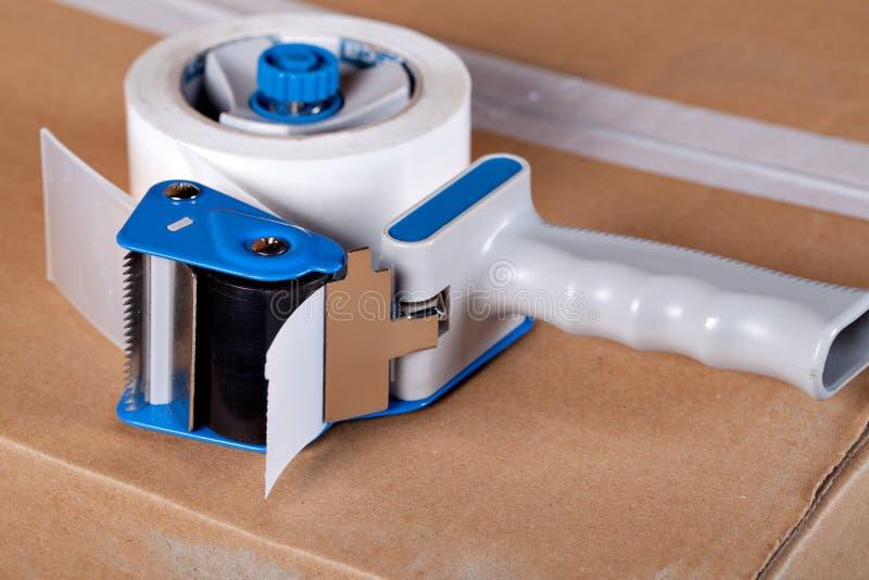 Dispensador de empaquetado del arma de la cinta fotos de archivo libres de regalías