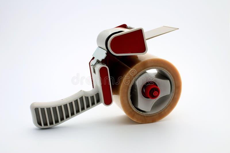 Dispensador de pila de discos de la cinta fotos de archivo