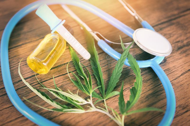 Dispensary Medical Marijuana leaf and cbd oil cannabis plant hemp extract medical healthcare natural for patient and stethoscope. On the table royalty free stock image