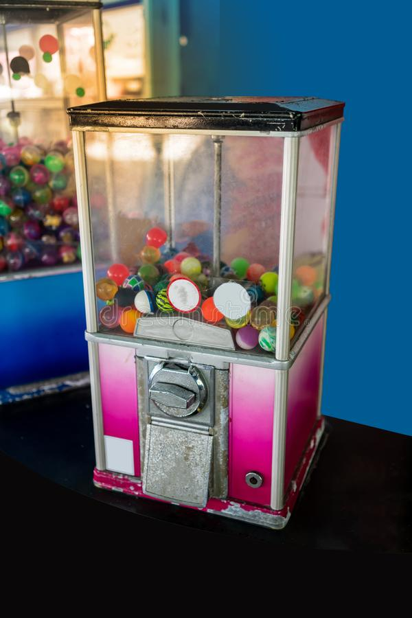 A dispenser of toys vending machine, full of rubber balls. Ret royalty free stock images