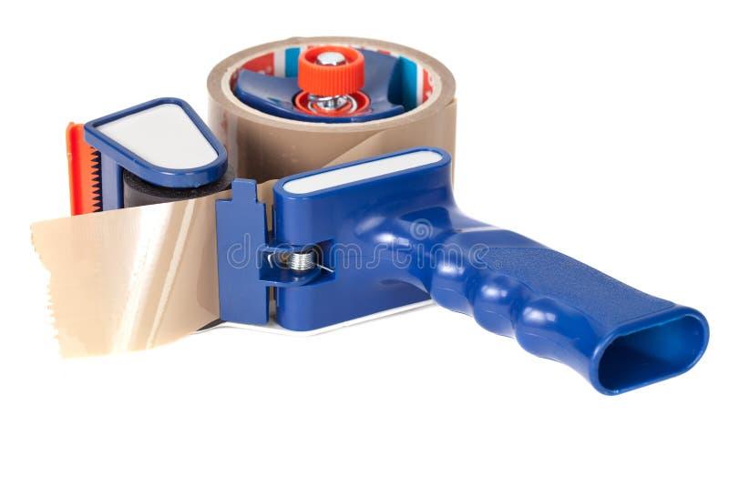 Dispensr pegajoso da fita fotografia de stock