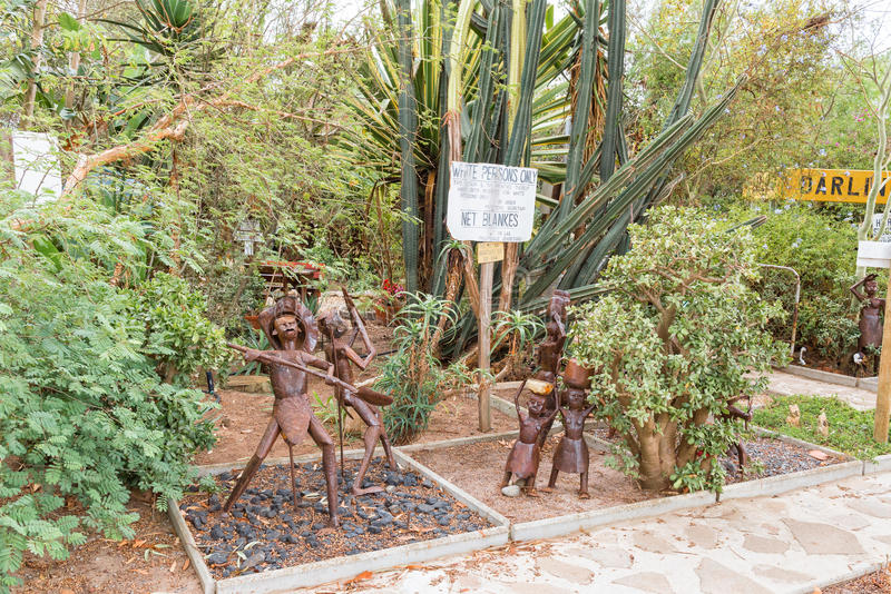 Display with apartheid sign and art at Evita se Perron. DARLING, SOUTH AFRICA - MARCH 31, 2017: A display with an apartheid era sign and art at Evita se Perron stock images