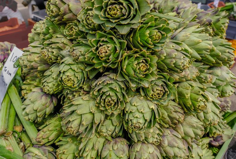 Display of artichokes on sale at a market stall royalty free stock photography