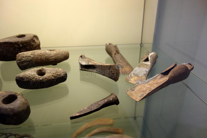 Display of Bronze and Stone Axes and Tools royalty free stock image