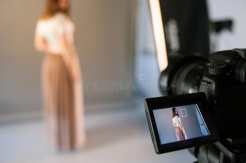 Display of camera with live view model photo. Beauty blogger shooting fashion video in studio stock photo