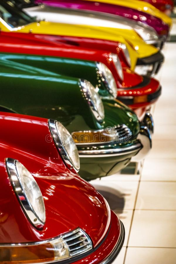Display of colorful classic sports cars in an exhibit hall stock photos