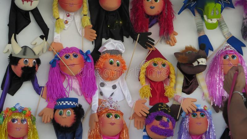 Display of colorful handmade puppets at local fair in Andalusa royalty free stock images