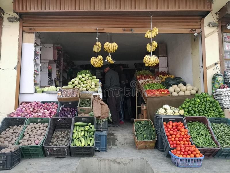Display of colorful wide selection of fruits and vegetables in a countryside of India. NEW DELHI , INDIA - MAY 19,2019 : Unidentified fruit and vegetable shops stock photo