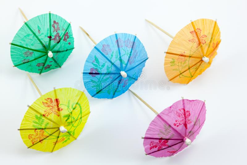 Display of different coloured cocktail umbrellas stock images