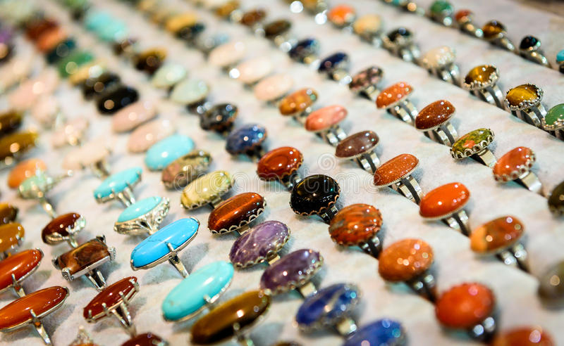 Display with different design of handmade rings with stones gems royalty free stock photography