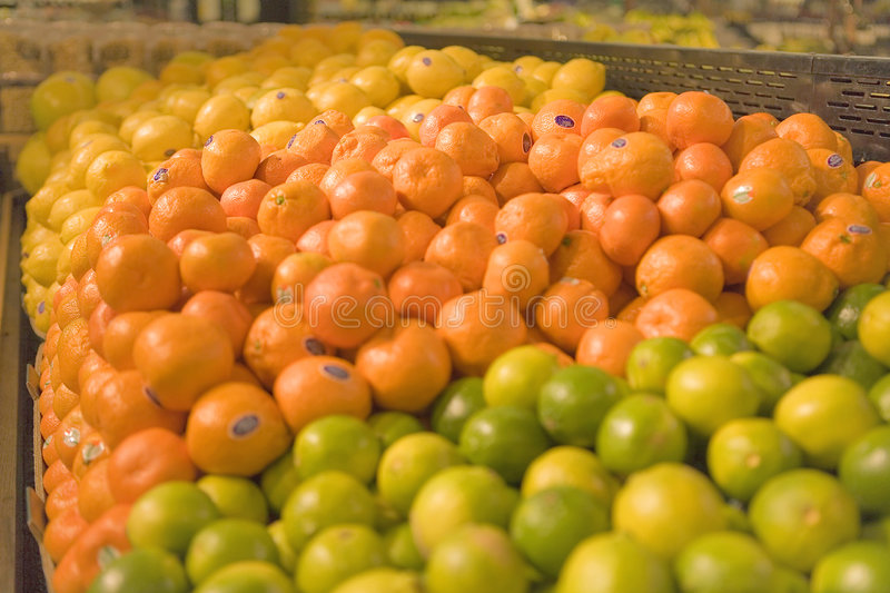 A display of fruits in a Grocery Store. With Lemona,Tangerines and Limes stock images