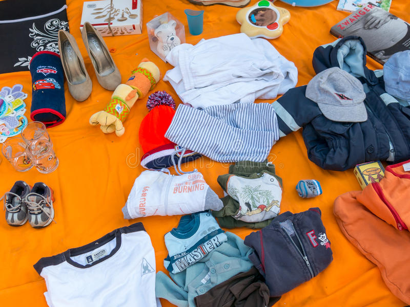 Display goods on King's Day flea market in Holland stock images