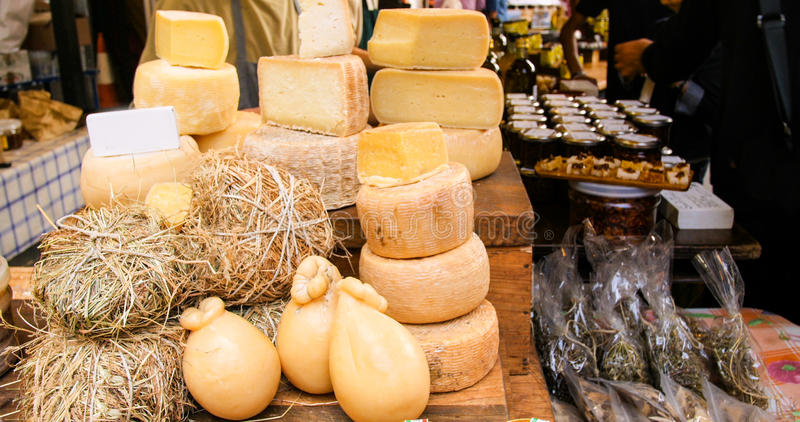 Display of Italian cheese in a food market stock image