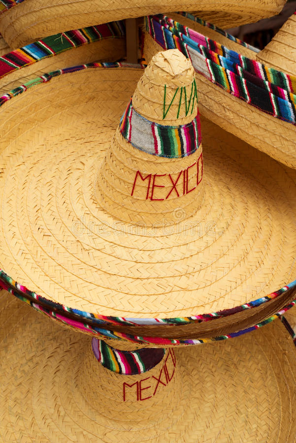 Display of mexican hats with viva mexico text royalty free stock photography