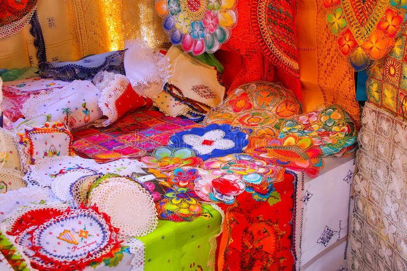 Display of nanduti at the street market in Asuncion, Paraguay. Nanduti is a traditional Paraguayan embroidered lace, introduced by the Spaniards royalty free stock images