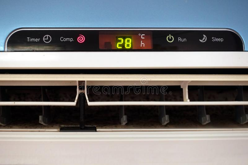 The display panel of a domestic AC or Air Conditioning unit, showing a temperature of 28 degrees celsius stock photo