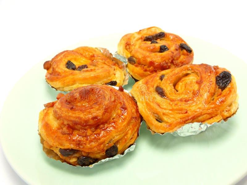 Display of raisin brioche sweet danish pastries. Raisin danish isolated on white background royalty free stock photos