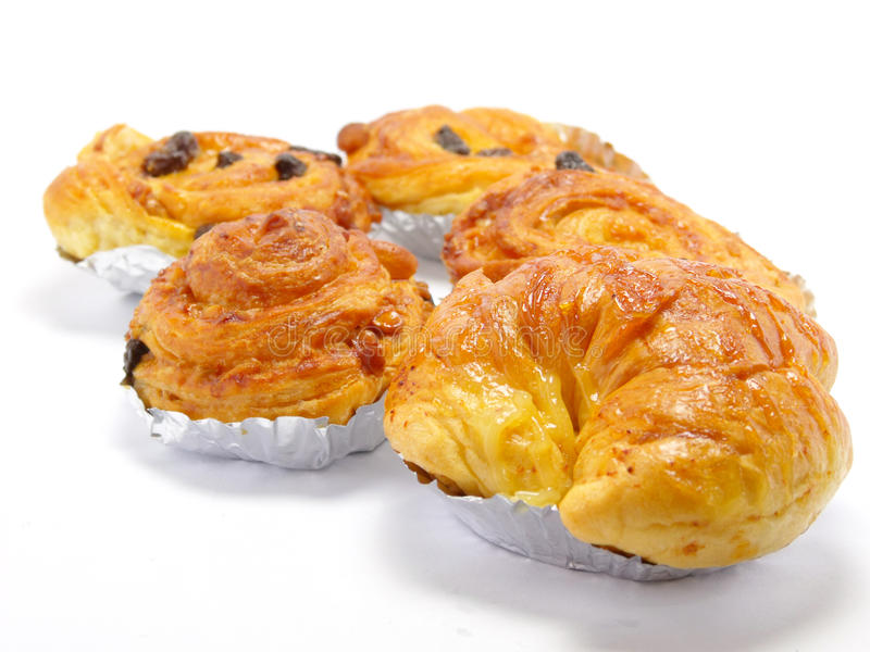 Display of raisin brioche sweet danish pastries. Danish pastry isolated on white background royalty free stock photo