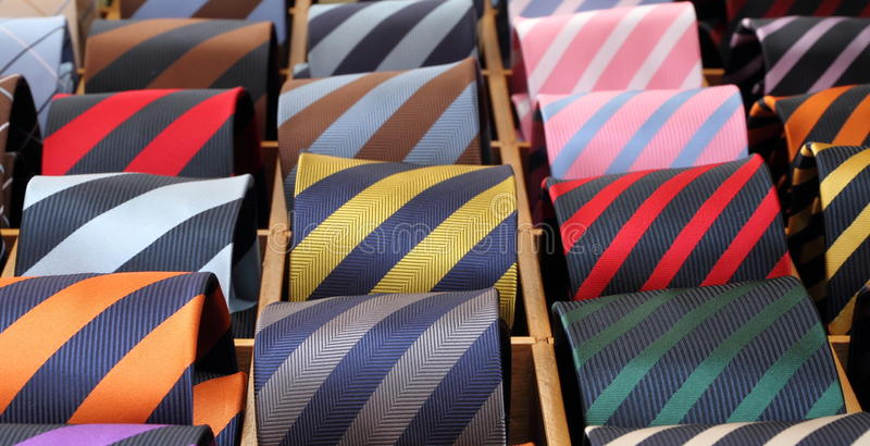 Display of silk striped ties. Italian striped colorful silk ties for sale royalty free stock image
