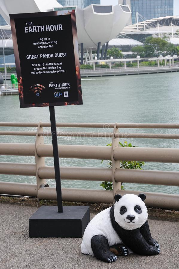 A display stand with a board from WWF World Wide Fund for Nature in Singapore. A photo taken on a display stand with a display board for Earth Day from WWF World stock photo