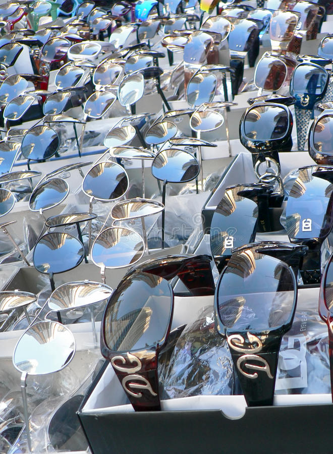 Display of sunglasses on city street stock photography