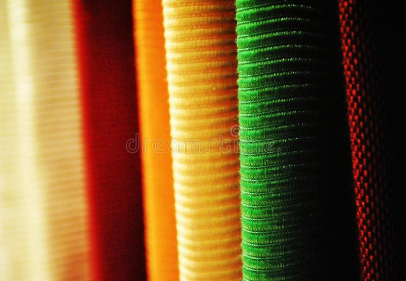 Display for textiles. Close-up on colorful textiles stock image
