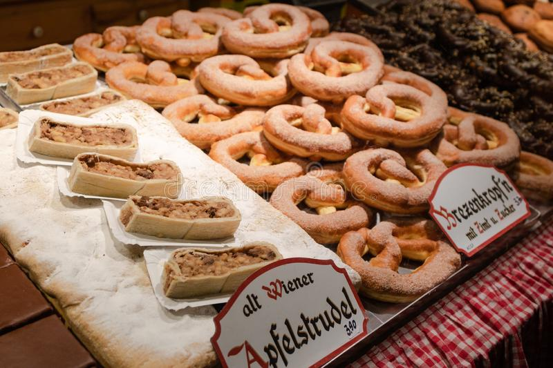 Display of traditional doughnuts on sale at street market stall in Vienna. Display of traditional doughnuts on sale at Christmas market stall in Austria stock images