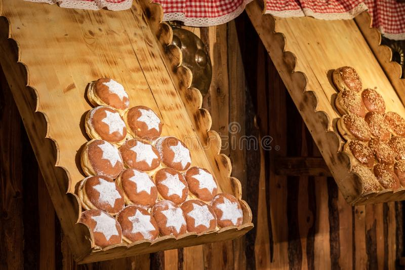 Display of traditional doughnuts on sale at street market stall in Vienna. Display of traditional doughnuts on sale at street market stall in Austria stock images