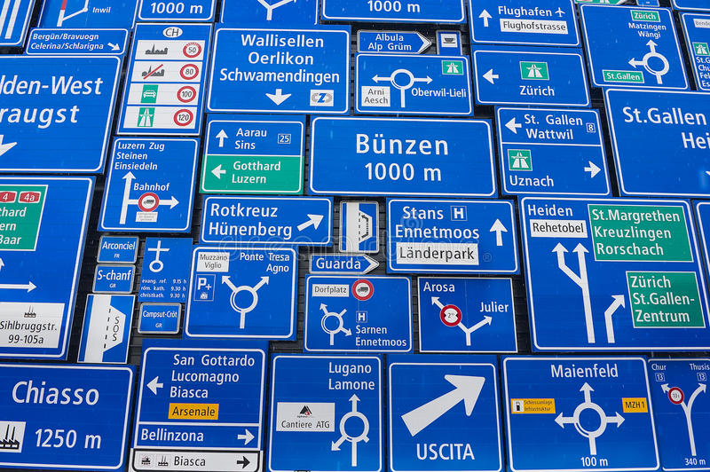 Display of the traffic signs at the exterior wall of the Swiss Museum of Transport in Lucerne, Switzerland. LUCERNE, SWITZERLAND - FEBRUARY 19, 2012: Display of stock photos
