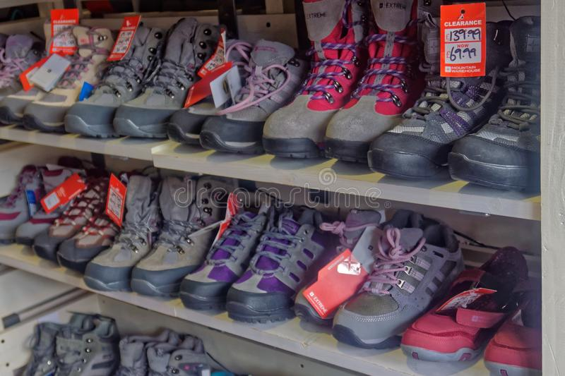A display of walking boots. An example of a shop display of modern walking and hiking boots for outdoor recreation royalty free stock photos