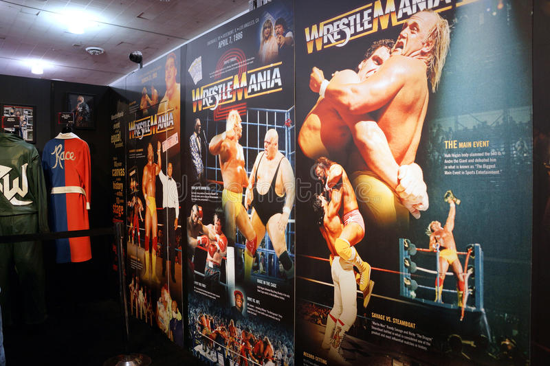 Display of Wrestlemania posters ranging from Wrestlemania 1-3 stock images