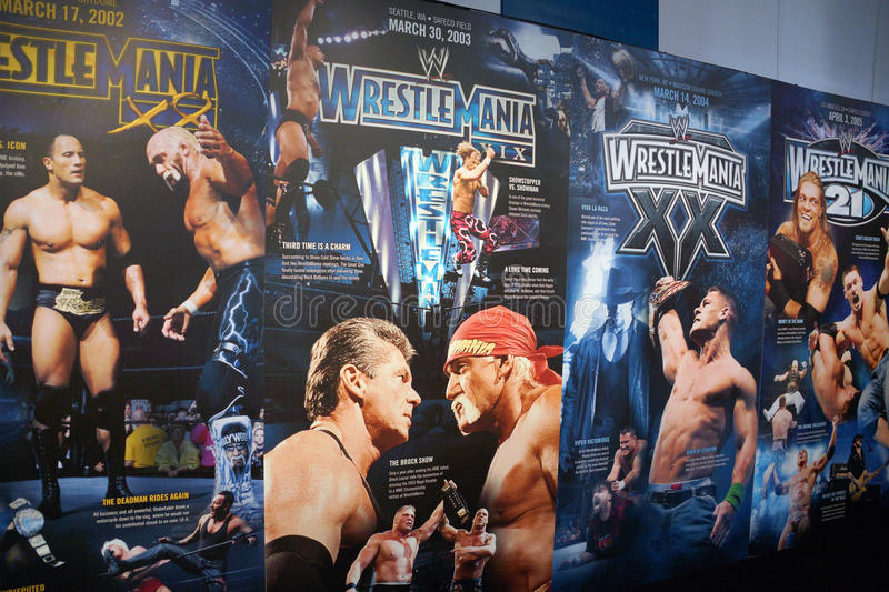 Display of Wrestlemania posters ranging from Wrestlemania 18-21 stock photography